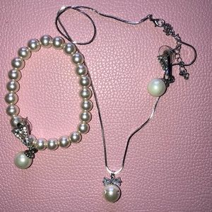 Set of pearl earrings necklace and a bracelet